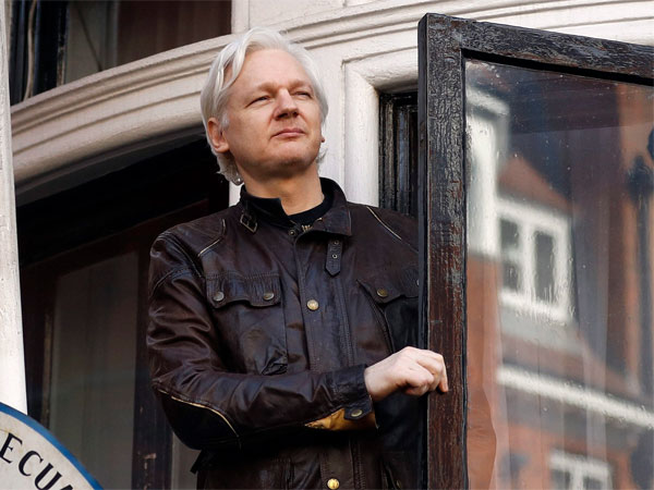 In this May 19, 2017 file photo, WikiLeaks founder Julian Assange greets supporters from a balcony of the Ecuadorian Embassy in London. PTI file photo