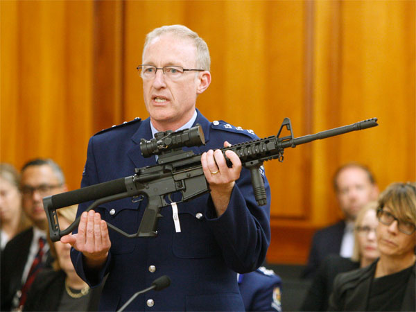 Police acting superintendent Mike McIlraith shows New Zealand lawmakers in Wellington on April 2, 2019, an AR-15 style rifle similar to one of the weapons a gunman used to slaughter 50 people at two mosques. PTI file photo