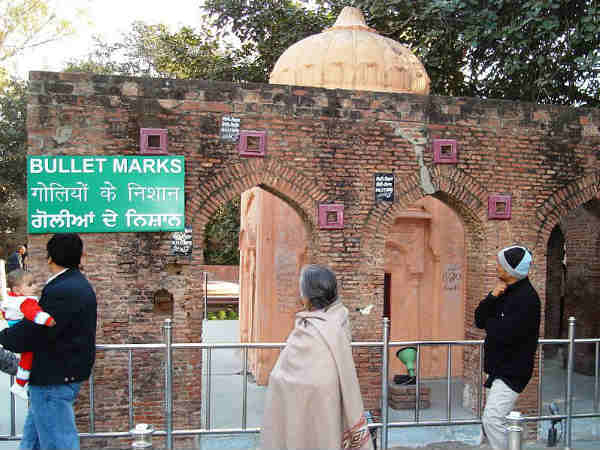Visitors look at the bullet marks of the infamous Jallianwala Bagh massacre. PTI file photo