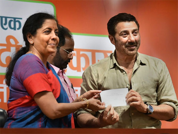 Defence Minister and BJP leader Nirmala Sitharaman presents the membership slip to actor Sunny Deol as he joins the party, at BJP headquarter, in New Delhi