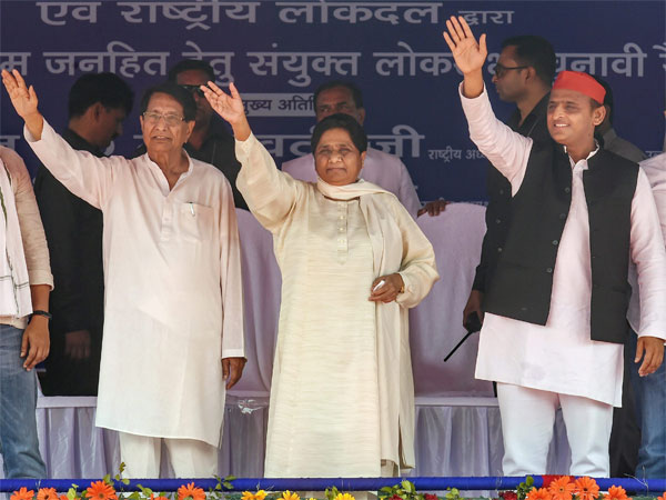 Samajwadi Party President Akhilesh Yadav, Bahujan Samaj Party supremo Mayawati, RLD chief Ch Ajit Singh wave at the supporters during their joint election campaign rally at Deoband in Saharanpur