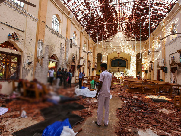 Dead bodies of victims lie inside St. Sebastians Church damaged in blast in Negombo, north of Colombo, Sri Lanka