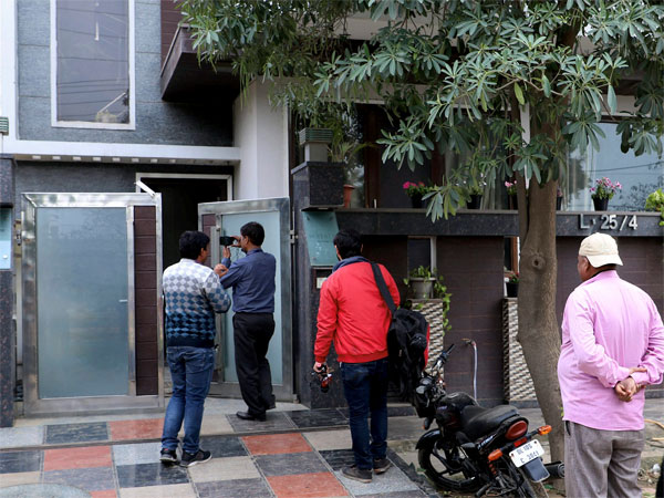 Media personnel and others outside Kashmiri businessman Zahoor Ahmed Watalis house as Enforcement Directorate (ED) personnel probe him in connection with terror funding case in J & K, in Gurugram