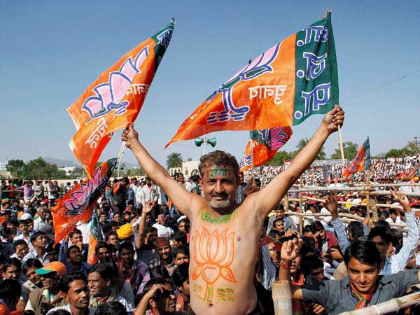 Exit polls: BJP celebrates, opposition plans on taking on EVMs