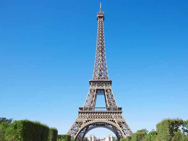 Eiffel Tower evacuated after man climbs the Paris landmark