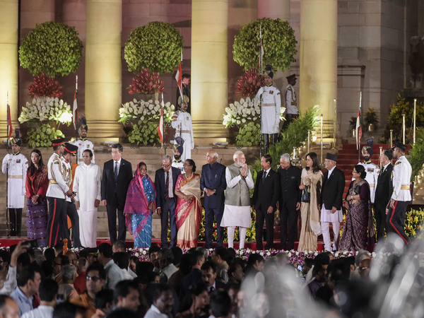 Prime Minister Narendra Modi with dignitaries in a group photograph after the oath-taking ceremony at Rashtrapati Bhavan in New Delhi, Thursday, May 30, 2019.