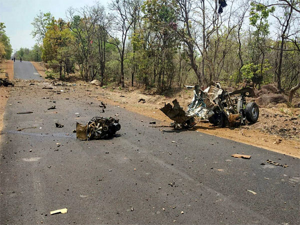 Mangled remains of a police vehicle, carrying 16 security personnel that was allegedly blasted by Maoists using IED, in Gadchiroli