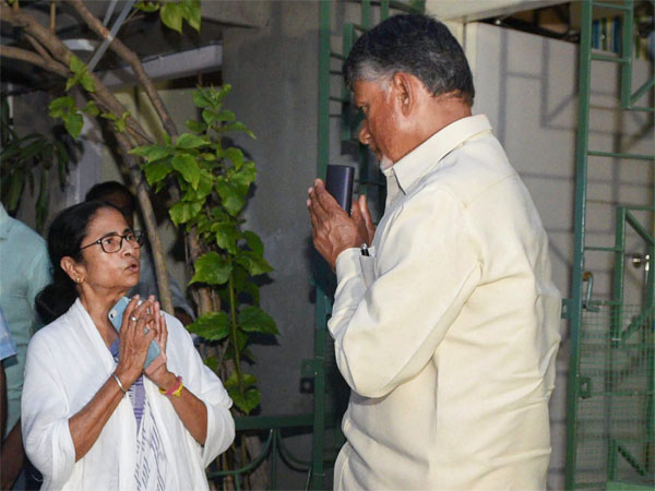 Andhra Pradesh Chief Minister and Telugu Desam Party President N Chandrababu Naidu greets West Bengal Chief Minister and Trinamool Congress chief Mamata Banerjee, at her residence in Kolkata