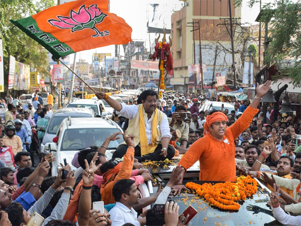 BJP candidate from Gorakhpur constituency Ravi Kishan appeals for votes during his roadshow for Lok Sabha polls, in Gorakhpur