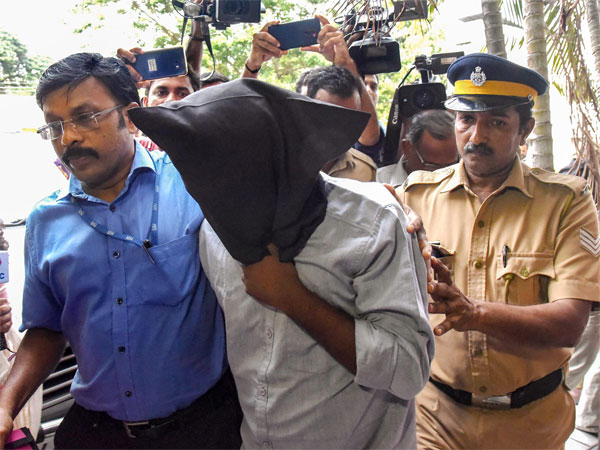 Riyas Aboobacker, arrested by the National Investigation Agency (NIA) for alleged links with IS links, being produced at a special court in Kochi, Tuesday, April 30, 2019. Aboobacker was arrested Monday after he disclosed that he has been following speeches and videos of Hashim, who masterminded the Easter Sunday blasts in Sri Lanka.