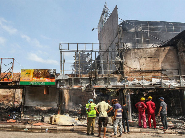 Sri Lankans inspect vandalized shops owned by Muslims in Minuwangoda, a suburb of Colombo, Sri Lanka
