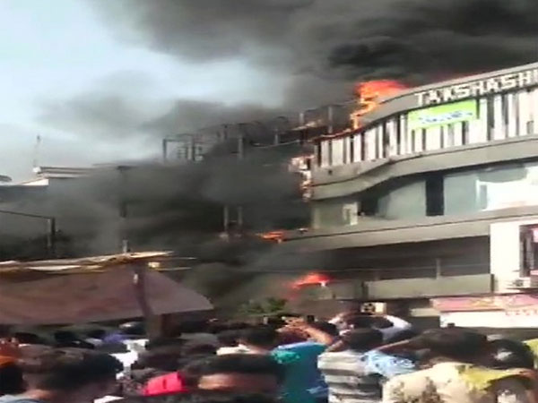 7 killed as fire breaks out in commercial complex in Surat, people jump from terrace