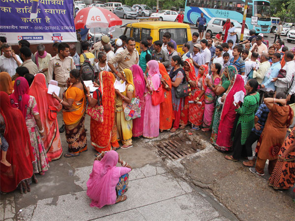 Pilgrims wait in queues to get themselves registered for Amarnath Yatra