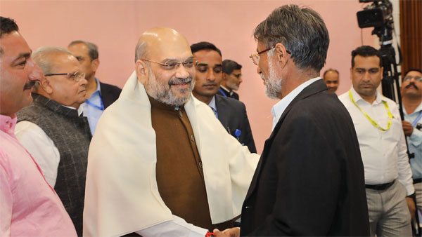 Union Home Minister Amit Shah meets with a delegation of sarpanchs, in Srinagar