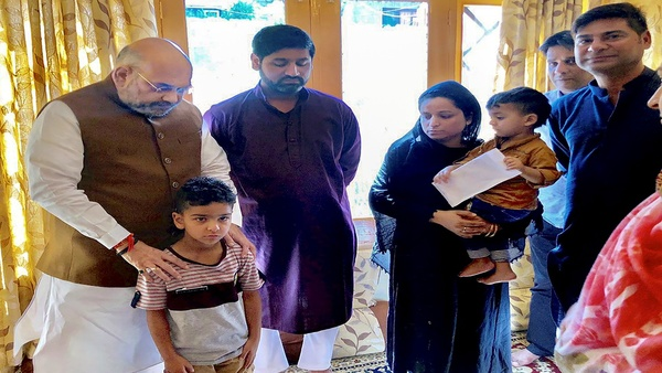 Union Home Minister Amit Shah visits the family of Jammu and Kashmir Police inspector Arshad Ahmed Khan, in Srinagar, Thursday, June 27, 2019 (PTI-Image)