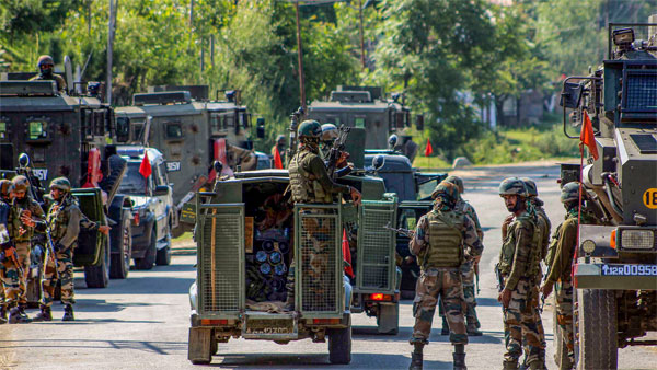 Army soldiers cordon off the area near the house where militants were hiding during an encounter in which one army Major and one militant were killed, at Achabal in Anantnag