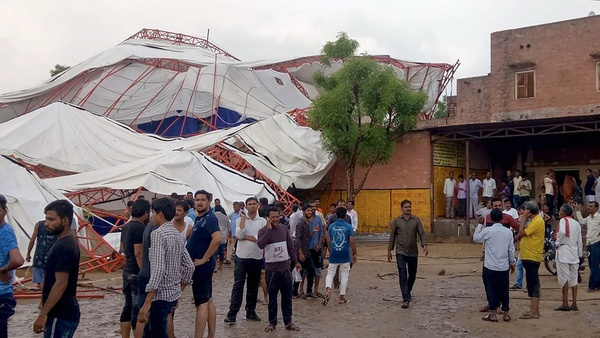 Barmer: Panic-stricken people after a pandal fell during a Ram Katha due to a storm in Jasol village of Barmer district, Sunday, June 23, 2019. (PTI photo)