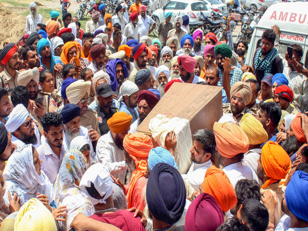 Family members and relatives carry the coffin of the two-year-old child Fatehveer for his last rituals, at their village Bhagwanpur in Sangrur district of Punjab