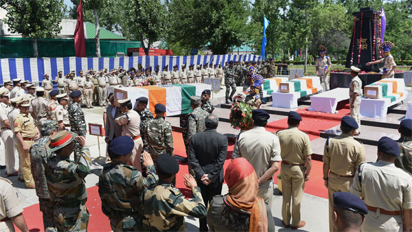 Senior security officers carry one of the coffins of the five CRPF men, who were killed on Wednesday when terrorists carried out an attack on a busy road in Anantnag district of south Kashmir