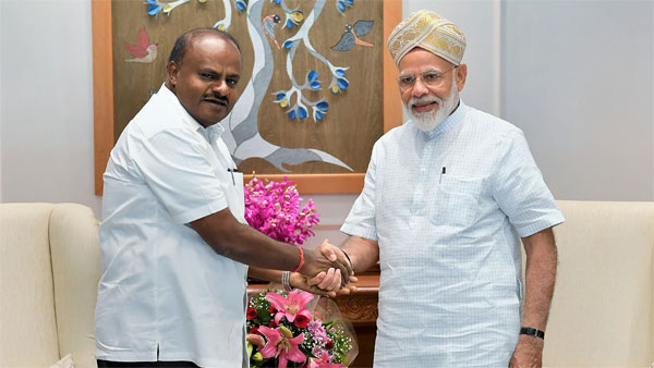 Prime Minister Narendra Modi being greeted by Chief Minister of Karnataka H.D. Kumaraswamy during a meeting, New Delhi