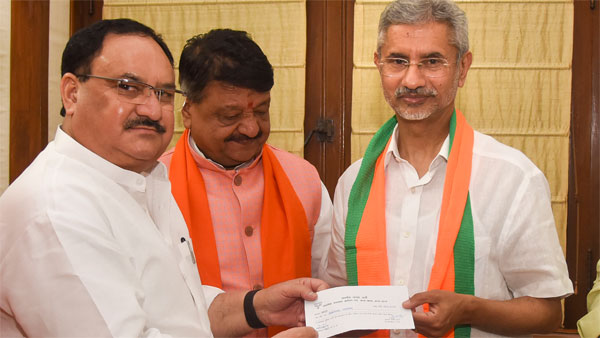 BJP Working President JP Nadda presents a membership slip to External Affairs Minister, S Jaishankar, as he formally joins Bharatiya Janata Party (BJP), in New Delhi