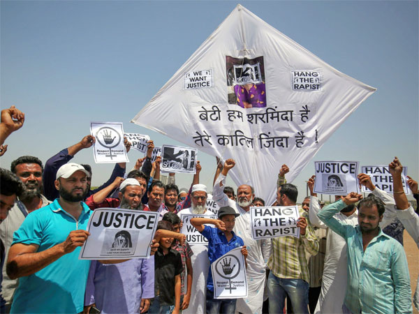 People display kites and placard during a protest against Kathua case. Photo credit: PTI