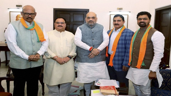 TDP Rajya Sabha MPs meet BJP President Amit Shah after joining the party