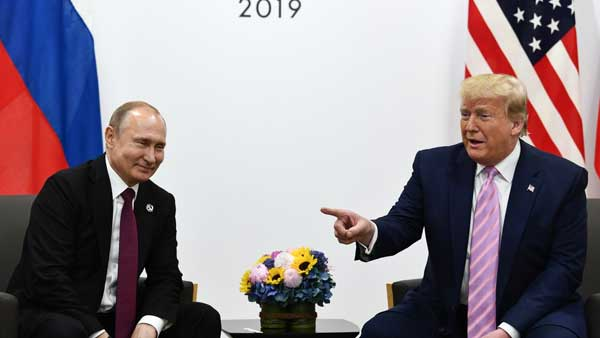 Dont meddle in the election, please: Smiling Trump tells Putin