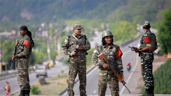 CRPF personnel keep vigil on Jammu-Srinagar National Highway ahead of the forthcoming Amarnath Yatra, in Jammu
