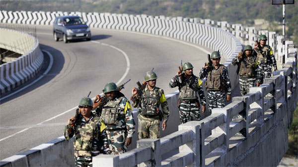 Central Reserve Police Force (CRPF) soldiers patrol the Jammu & Kashmir National Highway ahead of the upcoming Amarnath yatra, in Jammu district