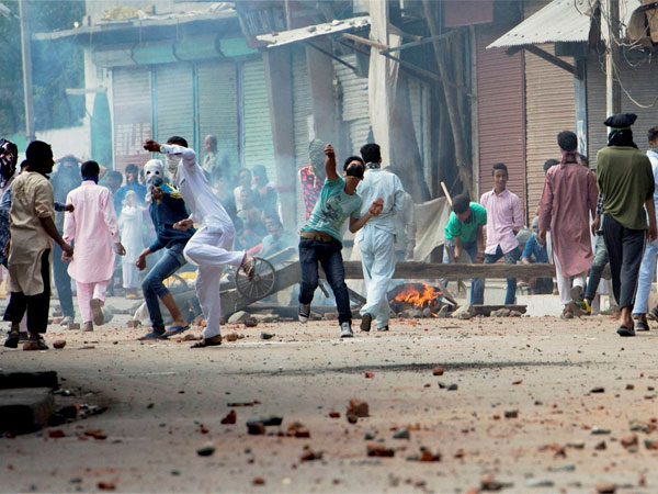 File photo of Youths pelting stones at security forces personnel