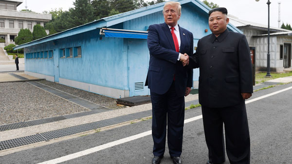 US-North Korea: Donald Trump shakes hands with Kim Jong-un at DMZ