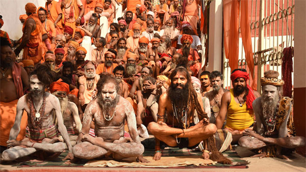 Sadhus perform yoga