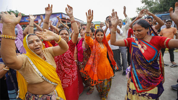 Pilgrims dance and chant religious slogans after the Amarnath Yatra was suspended
