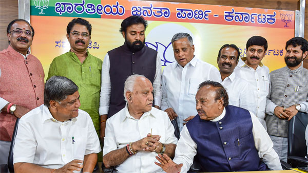 Karnataka BJP State President B S Yeduyurappa with party leaders Jagadish Shettar, K S Eshwarappa and others during the BJP legislator party meeting at the party office in Bengaluru