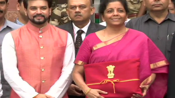 Sitharaman keeping budget documents in four fold red cloth instead of a briefcase
