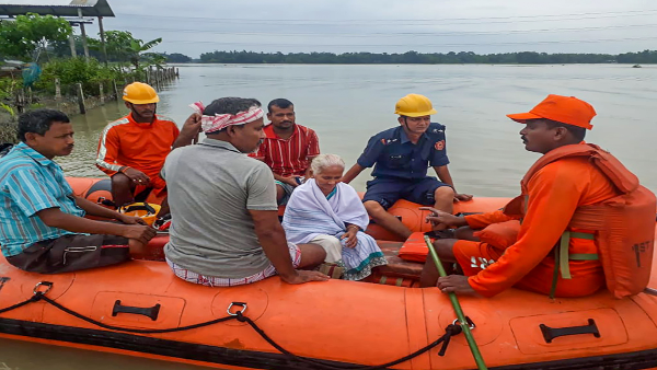 NDRF personnel conduct evacuation operation from the flood affected area