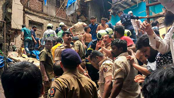 Police personnel and rescue teams at the site after a four-storey building collapsed at Dongri in Mumbai