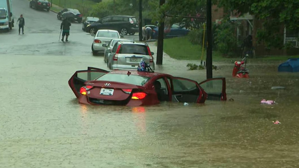 Washington hit by torrential rain, flash flooding and stranding drivers