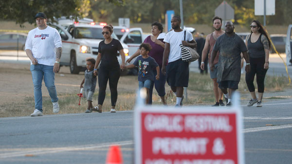 People leave the Gilroy Garlic Festival following a deadly shooting in Gilroy, Calif