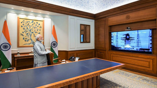 Prime Minister Narendra Modi watches on a screen the successful launch of Chandrayaan-2