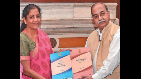 Nirmala Sitharaman receiving the report submitted by Akhilesh Ranjan, Convener of the Task force