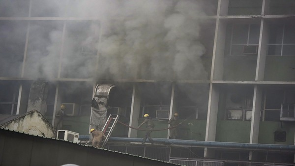 Fire brigade pesonnel fighting blaze which broke out at the teaching block