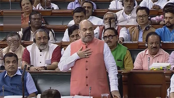 Union Home Minister Amit Shah speaks during discussion on the resolution to revoke Article 370, in the Lok Sabha