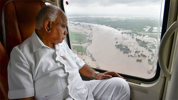 Karnataka Chief Minister B S Yediyurappa during his aerial survey of the flood affected areas