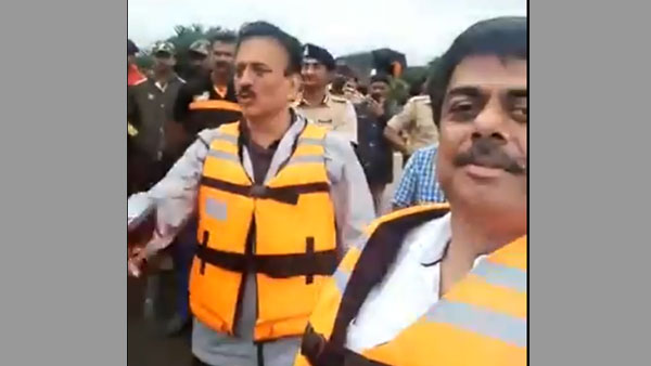Watch video of Maharashtra Minister on flood survey caught smiling and waving