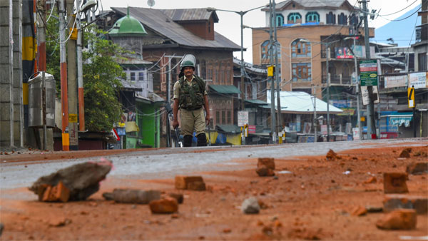 A security personnel stands guard during curfew like restriction on fifth consecutive day in Srinagar