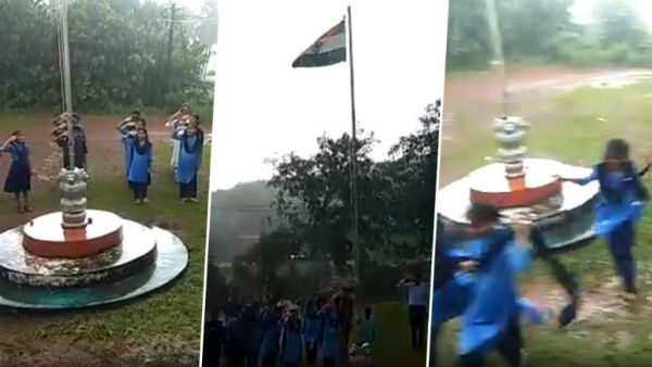 Watch: Despite heavy rains, school students continue singing National Anthem