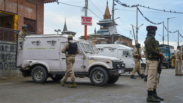 Security personnel stand guard in Srinagar