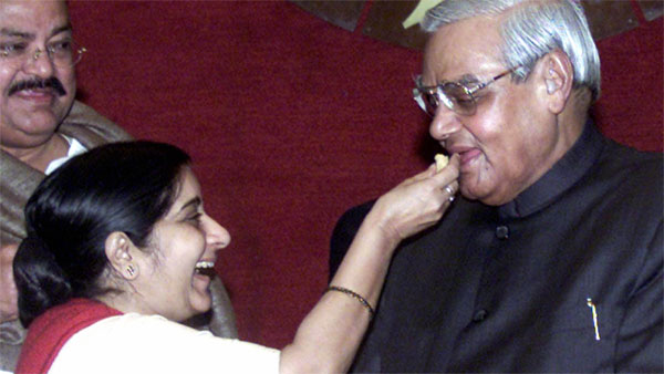 Sushma offers sweet to Vajpayee